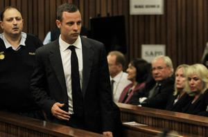 Oscar Pistorius arrives for his trial at the high court in Pretoria, South Africa, Monday, March 3, 2014. Pistorius is charged with murder with premeditation in the shooting death of girlfriend Reeva Steenkamp in the pre-dawn hours of Valentine's Day 2013. (AP Photo/Themba Hadebe, Pool)