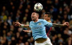 Manchester City's Aleksandar Kolarov battles for the ball with FC Barcelona's Alexis Sanchez during the UEFA Champions League, Round of 16 match at the Etihad Stadium, Manchester. PRESS ASSOCIATION Photo. Picture date: Tuesday February 18, 2014. See PA story SOCCER Man City. Photo credit should read: Martin Rickett/PA Wire