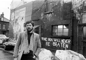 """Gerry Adams pictured outside the Sinn Fein HQ with graffiti """"The IRA will never be beaten"""" in 1984. PACEMAKER PRESS INTL"""