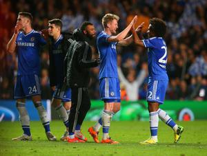 LONDON, ENGLAND - APRIL 08:  Andre Schurrle of Chelsea celebrates victory with Willian of Chelsea and Ashley Cole of Chelsea during the UEFA Champions League Quarter Final second leg match between Chelsea and Paris Saint-Germain FC at Stamford Bridge on April 8, 2014 in London, England.  (Photo by Julian Finney/Getty Images)