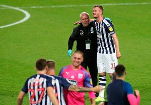 West Brom captain Chris Brunt celebrates sealing promotion in his final game for the club.