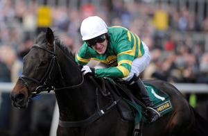 Aintree Races...LIVERPOOL, ENGLAND - APRIL 05:  Tony McCoy riding At Fishers Cross clear the last to win The John Smith's Sefton Novices Hurdle Race at Aintree racecourse on April 05, 2013 in Liverpool, England. (Photo by Alan Crowhurst/Getty Images)...S