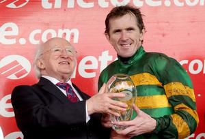 Tony McCoy presented with the Galway Plate by President Michael D Higgins 31/7/2013...2013 Galway Festival, Ballybrit, Galway 31/7/2013 The www.thetote.com Galway Plate Carlingford Lough jockey Tony McCoy presented with the Galway Plate by President Michael D Higgins Mandatory Credit ©INPHO/James Crombie...