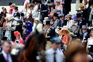 ASCOT, ENGLAND - JUNE 20:  Racegoers watch horses walk the parade ring on Ladies' Day during day three of Royal Ascot at Ascot Racecourse on June 20, 2013 in Ascot, England.  (Photo by Alan Crowhurst/Getty Images for Ascot Racecourse)