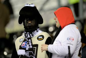 A Derby fan, dressed as a ram, waits ahead of the FA cup fourth round football match between Derby County and Manchester United at Pride Park stadium in Derby on January 29, 2016.