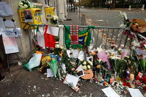 Floral tributes continue to be left near the Bataclan concert hall in Paris following the terrorist attacks on Friday evening. PRESS ASSOCIATION Photo. Picture date: Monday November 16, 2015. See PA story POLICE Paris. Photo credit should read: Steve Parsons/PA Wire