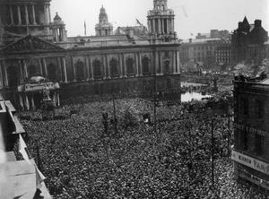 World War 2:  VE - Day.  Crowd listening to Prime Minister Winston Churchill's broadcast at Belfast City Hall.  (08/05/1945)