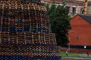 "A completed bonfire in the Hopewell area in the Lower Shankill, Belfast, as building continues on huge loyalist bonfires, which are traditionally lit on the ""Eleventh night"" to usher in the Twelfth commemorations. PRESS ASSOCIATION Photo. Picture date: Sunday July 10, 2016. Authorities in Northern Ireland are cautiously optimistic the main fixture in the loyal order parading season can pass off peacefully, but have a major policing operation planned to deal with any unrest. See PA story ULSTER Twelfth. Photo credit should read: Brian Lawless/PA Wire"