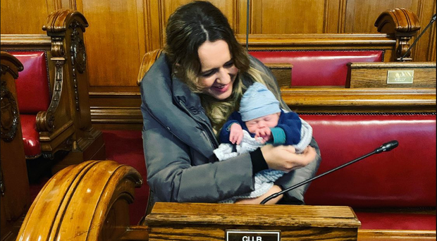 Kate Nicholl and seven-week-old Cian in the council chamber