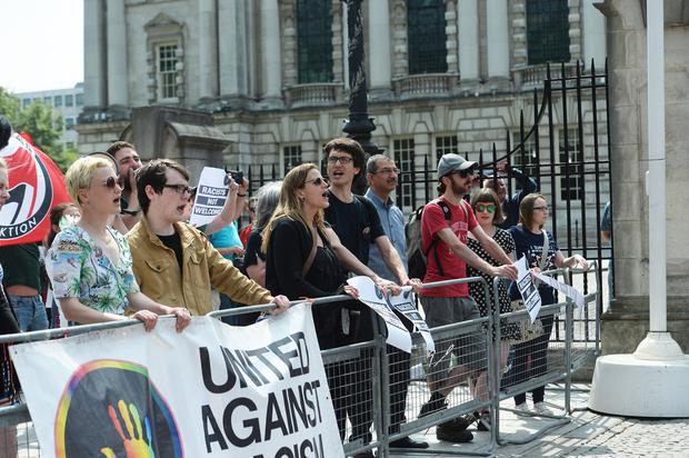 Pacemaker 09/06/2018 Counter protesters at A rally at Belfast City hall on Saturday in support of Tommy Robinson, the founder of the far-right English Defence League, who was  jailed for 13 months for contempt of court after broadcasting an hour-long video over Facebook from outside Leeds crown court. Pic Pacemaker