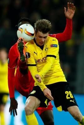 Dortmund's Polish defender Lukasz Piszczek (R) and Liverpool's Belgian striker Divock Origi vie for the ball during the UEFA Europe League quarter-final, first-leg football match Borussia Dortmund vs Liverpool FC in Dortmund, western Germany on April 7, 2016. / AFP PHOTO / ODD ANDERSENODD ANDERSEN/AFP/Getty Images