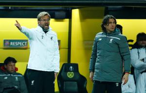 Liverpool's German head coach Jurgen Klopp (L) and Liverpool's Serbian assistant manager Zeljko Buvac react from the sidelines during the UEFA Europe League quarter-final, first-leg football match Borussia Dortmund vs Liverpool FC in Dortmund, western Germany on April 7, 2016. / AFP PHOTO / ODD ANDERSENODD ANDERSEN/AFP/Getty Images