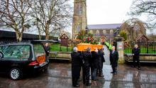 Family members carry the coffin of former Manchester United goalkeeper, Munich air crash survivor, Harry Gregg for the funeral service at St Patrick's Parish Church in Coleraine, Northern Ireland on February 21, 2020 (Photo by PAUL FAITH/AFP via Getty Images)