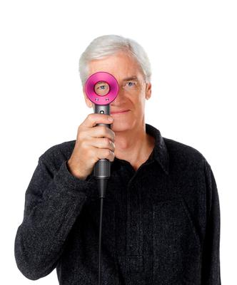 Sir James Dyson with his company's new Supersonic hair dryer, which features its trademark bladeless fan. Picture: Dyson/PA Wire