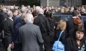 PACEMAKER BELFAST   24/08/2014 Mourners   during the Funeral of veteran Broadcaster Gerry Anderson at St Eugene's Cathedral in Derry on Sunday,  The Derry native started his 30-year career in the city, working as a radio presenter at Radio Foyle in 1984, before going on to become a household name in Northern Ireland.  He died on Thursday after a long illness.   Photo Colm Lenaghan/Pacemaker Press