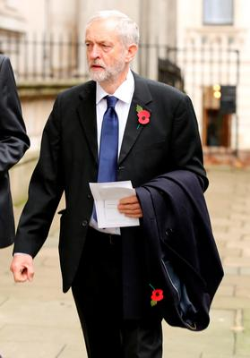Labour party leader Jeremy Corbyn walks through Downing Street on his way to the annual Remembrance Sunday service at the Cenotaph memorial in Whitehall. Chris Radburn/PA Wire.