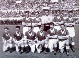 Football:Northern Ireland 1957. Alf McMichael (second left back row) was a member of the Northern Ireland team which lost 1-0 to Italy in a World Cup tie at the Olympic Stadium, Rome in April 1957. FRONT: (from left) Jimmy McIlroy, Bertie Peacock, Eddie mcMorran, Danny Blanchflower, Billy Bingham, Wilbur Cush. BACK: Billy Simpson, Alfie McMichael, Harry Gregg, Willie Cunningham and Tommy Casey.