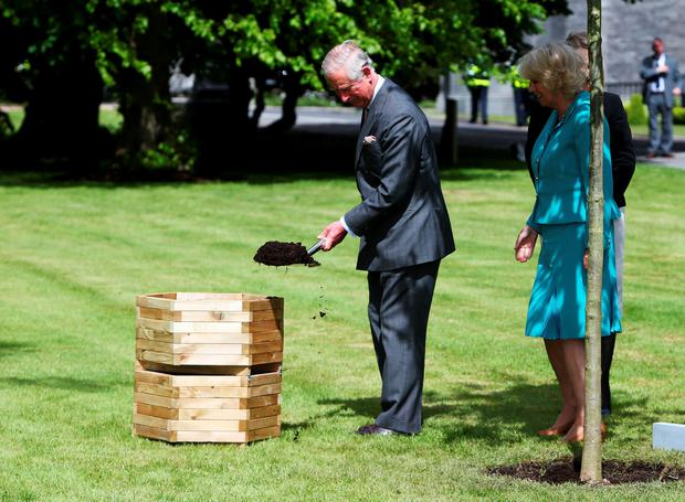 GALWAY, IRELAND - MAY 19:  Prince Charles, Prince Of Wales and Camilla, Duchess of Cornwall plant an oak tree at a welcome reception at National University of Ireland on May 19, 2015 in Galway, Ireland. The Prince of Wales and Duchess of Cornwall arrived in Ireland today for their four day visit to the Republic and Northern Ireland, the visit has been described by the British Embassy as another important step in promoting peace and reconciliation. (Photo by Brian Lawless - WPA Pool/Getty Images)