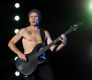 """INDIO, CA - APRIL 14:  Musician Michael """"Flea"""" Balzary of the band Red Hot Chili Peppers performs onstage during day 3 of the 2013 Coachella Valley Music & Arts Festival at the Empire Polo Club on April 14, 2013 in Indio, California.  (Photo by Kevin Winter/Getty Images for Coachella)"""