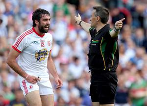 Tyrone's Joe McMahon argue with referee Maurice Deegan after he awarded Mayo a penalty
