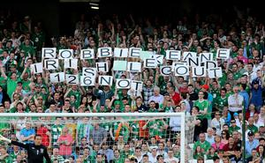 Fans hold up signs after Republic of Ireland's Robbie Keane scores his side's first goal of the game during the FIFA World Cup Qualifying match at the Aviva Stadium, Ireland. PRESS ASSOCIATION Photo. Picture date: Friday June 7, 2013. See PA story SOCCER Republic. Photo credit should read: Niall Carson/PA Wire