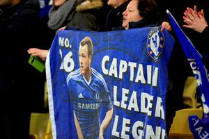 "Chelsea fans hold a banner in support of John Terry in the stands during the Barclays Premier League at Vicarage Road, London. PRESS ASSOCIATION Photo. Picture date: Wednesday February 3, 2016. See PA story SOCCER Watford. Photo credit should read: Adam Davy/PA Wire. RESTRICTIONS: EDITORIAL USE ONLY No use with unauthorised audio, video, data, fixture lists, club/league logos or ""live"" services. Online in-match use limited to 75 images, no video emulation. No use in betting, games or single club/league/player publications."