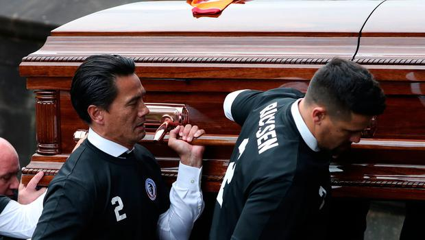 Pallbearer's including former Rangers players Michael Mols and Nacho Novo carry the coffin of former Rangers footballer Fernando Ricksen at Wellington Church, Glasgow. PA Photo. Picture date: Wednesday September 25, 2019. The former Holland international died aged 43 a week ago, six years after being diagnosed with motor neurone disease. Ricksen played more than 250 times for the Light Blues after joining from AZ Alkmaar in 2000, winning two league titles during his time in Glasgow. See PA story SOCCER Ricksen. Photo credit should read: Andrew Milligan/PA Wire.