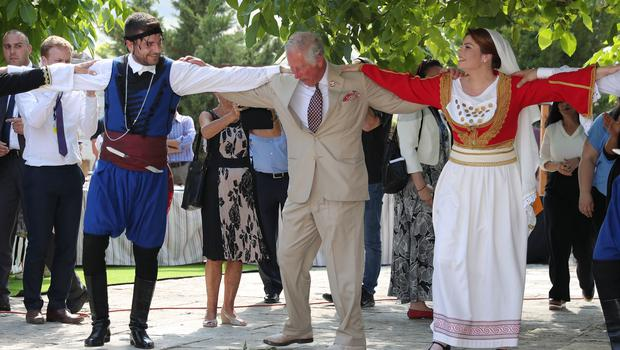 Before the royal couple had a go at Greek dancing in Archanes. Here's the Prince of Wales... (Andrew Matthews/PA)