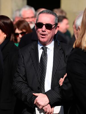 Former boxer Dave 'Boy' McAuley leaves the church following the funeral of boxing promoter and bookmaker Barney Eastwood at St Colmcille's Church, Holywood, Co Down. PA Photo. Picture date: Friday March 13, 2020. See PA story FUNERAL Eastwood. Photo credit should read: Liam McBurney/PA Wire