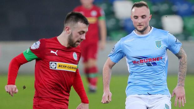 County Antrim Shield Final -  Windsor Park.  21.01.20  Cliftonville FC vs Ballymena United  CliftonvilleÕs Conor McMenamin with BallymenaÕs Jude Wincherster  Mandatory Credit ©INPHO/Jonathan Porter