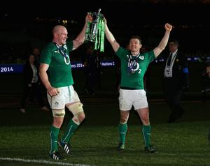 Captain, Paul O'Connell of Ireland and Brian O'Driscoll celebrate with the Six Nations Championship during the RBS Six Nations match between France and Ireland at Stade de France on March 15, 2014 in Paris, France.  (Photo by Julian Finney/Getty Images)