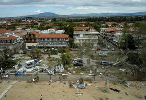 People search and clean a damaged square after a storm at Sozopoli village in Halkidiki region, northern Greece. Credit: Vassilis Konstantopoulos/InTime News via AP