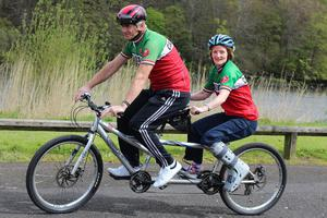 Violet McAfee and Robert Downes on board the tandem they will tackle the NW200 course on