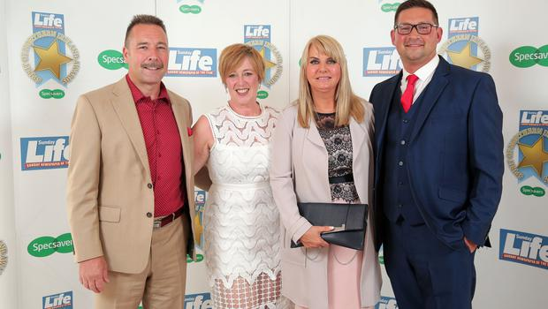 Press Eye - Belfast - Northern Ireland - 16th June 2017 -   Dr Sam Sittlington, Elaine Sittlington, Mandy Irwin and Craig Irwin pictured at the Sunday Life Spirit of Northern Ireland Awards with Specsavers at the Culloden Hotel. Photo by Kelvin Boyes / Press Eye.