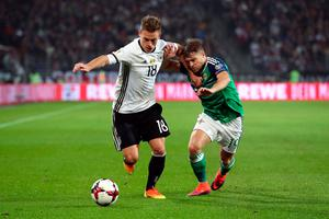 Germany's Joshua Kimmich (left) and Northern Ireland's Jamie Ward battle for the ball during the 2018 FIFA World Cup Qualifying match at the HDI Arena, Hannover. PA