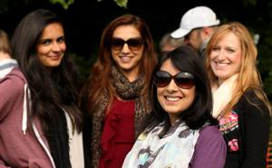 Tennis fans (left to right) Sharney Randhawa, Karen Randhawa, Manveer Kaur and Jen Emms wait in the queue during day Three of the Wimbledon Championships at The All England Lawn Tennis and Croquet Club, Wimbledon. PRESS ASSOCIATION Photo. Picture date: Wednesday June 26, 2013. See PA story TENNIS Wimbledon. Photo credit should read: John Walton/PA Wire. RESTRICTIONS: Editorial use only. No commercial use. No video emulation. No use with any unofficial third party logos.