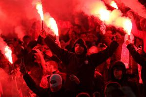 Polish fans set off red flares in the stands prior to kick-off during the FIFA 2014 World Cup Qualifying, Group H match at Wembley Stadium, London.