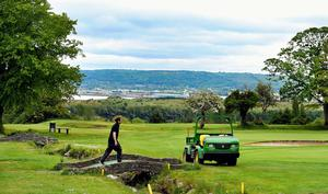 Fortwilliam greenkeeper Chris Kerr busy preparing the course before this week's reopening.
