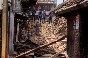 KATHMANDU, NEPAL - APRIL 27:  Rescue team members search for bodies in the debris of a collapsed temple at Basantapur Durbar Square on April 27, 2015 in Kathmandu, Nepal. A major 7.8 earthquake hit Kathmandu mid-day on Saturday, and was followed by multiple aftershocks that triggered avalanches on Mt. Everest that buried mountain climbers in their base camps. Many houses, buildings and temples in the capital were destroyed during the earthquake, leaving over 3000 dead and many more trapped under the debris as emergency rescue workers attempt to clear debris and find survivors.  (Photo by Omar Havana/Getty Images) *** BESTPIX ***