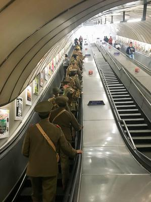 Men dressed as First World War soldiers in Euston station, London, to mark 100 years since the start of the Battle of the Somme. PRESS ASSOCIATION Photo. Picture date: Friday July 1, 2016. The imitation soldiers surprised onlookers by stopping to pose and sing wartime songs, and when not singing, the men remained silent, handing out cards with names of those who had died to members of the public. See PA story HERITAGE Somme Tributes. Photo credit should read: Sarah Perry/PA Wire