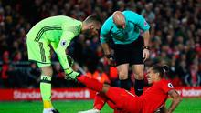 Load of cramp : Despite David de Gea's best efforts, he still couldn't get Roberto Firmino's leg tuned in to Sky HD on Monday