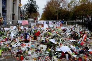 Floral tributes and messages lie at the police cordon in front of the Bataclan concert hall in Paris on November 16, 2015 , three days after  terrorist attacks left over 130 dead and more than 350 injured. France prepared to fall silent at noon on November 16 to mourn victims of the Paris attacks after its warplanes pounded the Syrian stronghold of Islamic State, the jihadist group that has claimed responsibility for the slaughter.   AFP PHOTO / BERTRAND GUAYBERTRAND GUAY/AFP/Getty Images