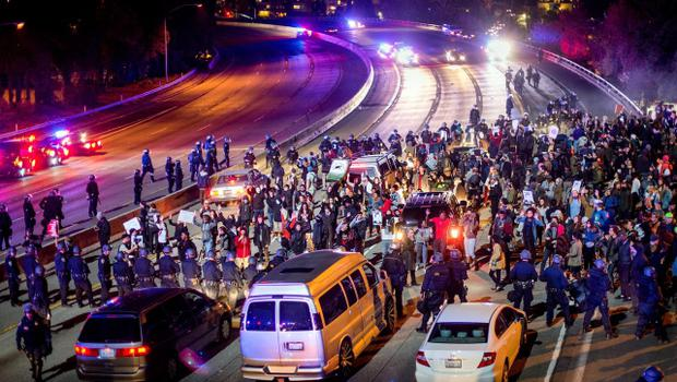 Protesters block Interstate 580 in Oakland, Calif., on Monday, Nov. 24, 2014,  after the announcement of the grand jury decision not to indict Ferguson police officer Darren Wilson in the fatal shooting of Michael Brown, an unarmed 18-year-old. (AP Photo/Noah Berger)