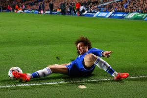 LONDON, ENGLAND - APRIL 08: David Luiz of Chelsea clears the ball to avoid a corner during the UEFA Champions League Quarter Final second leg match between Chelsea and Paris Saint-Germain FC at Stamford Bridge on April 8, 2014 in London, England.  (Photo by Julian Finney/Getty Images)