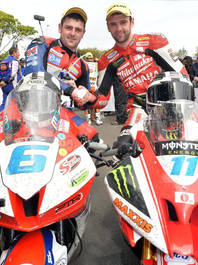 PACEMAKER BELFAST 03/06/13: Brothers Michael (MD Racing Honda) and William Dunlop (Milwaukee Yamaha) in the winners enclosure after finishing first and third in the opening Monster Energy supersport race on his MD Racing Honda at the 2013 Isle of Man TT PHOTO BY STEPHEN DAVISON/PACEMAKER