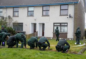 Police scour the scene of the shooting in Coleraine. Pic Kevin McAuley/McAuley Multimedia