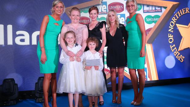 SPIRIT OF HEALTH  Winner of the Spirit of Health award, Rosie Mulholland from Craigavon, is presented with her trophy by Sarah Shimmons, from category sponsor Linwoods and local actress Niamh McGrady. Also pictured are ambassadors from title sponsor Specsavers, Nicola and Alison Crimmins. Rosie was one of ten winners at the Sunday Life Spirit of Northern Ireland Awards with Specsavers.