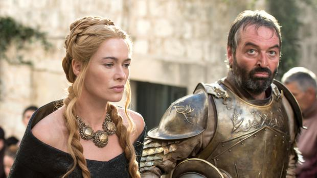 Lena Headey as Cersei Lannister and Ian Beattie as Meryn Trant from Game of Thrones