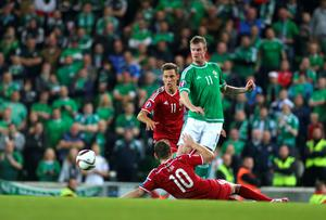Northern Ireland's Chris Brunt battles for the ball with Hungary's Zoltan Gera (floor) and Krisztian Nemeth during the UEFA European Championship Qualifying match at Windsor Park, Belfast. PRESS ASSOCIATION Photo. Picture date: Monday September 7, 2015. See PA story SOCCER N Ireland. Photo credit should read: Liam McBurney/PA Wire
