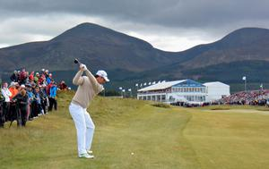 NEWCASTLE, NORTHERN IRELAND - MAY 28:  Padraig Harrington of Ireland plays his second shot on the par five 18th hole during the First Round of the Dubai Duty Free Irish Open Hosted by the Rory Foundation at Royal County Down Golf Club on May 28, 2015 in Newcastle, Northern Ireland.  (Photo by Ross Kinnaird/Getty Images)